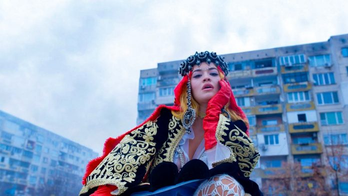 Rita Ora in national dress appears on the giant billboards