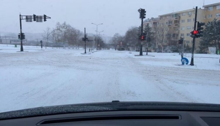 The large amount of snow on the streets of Prishtina,