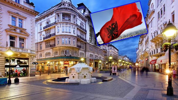 The Albanian flag flutters between Serbia